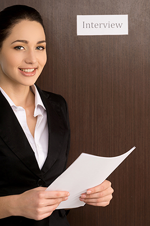 Smiling confident woman standing with CV. Getting ready for interview